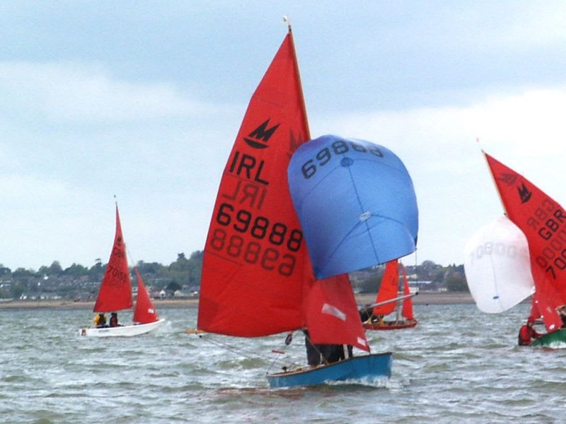 Mirrors racing on a run with spinnakers flying
