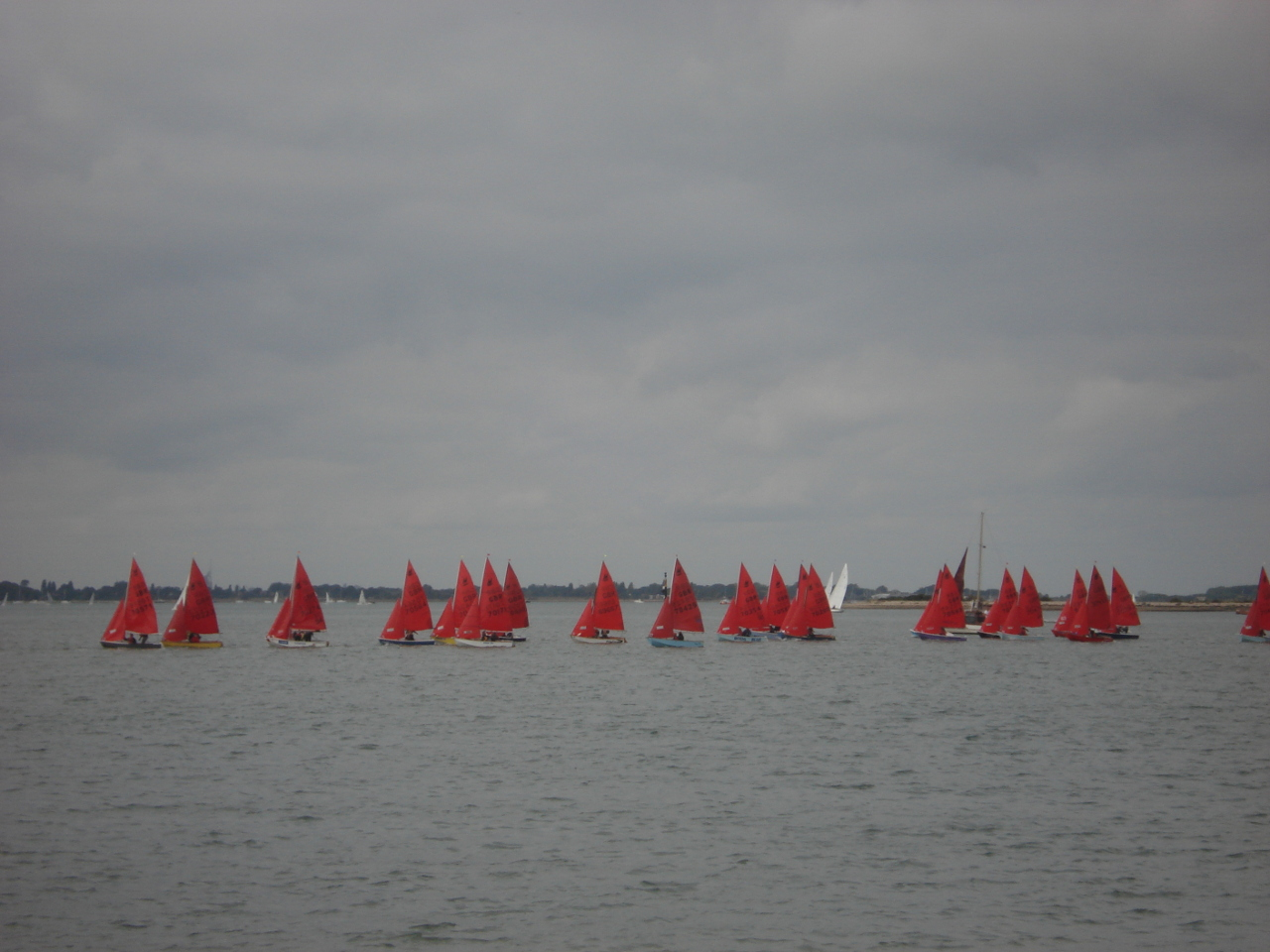A fleet of Mirrors starting a race in the distance on a cloudy day