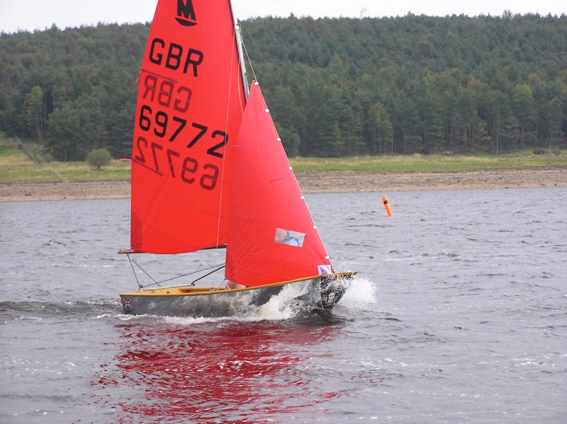 A Mirror dinghy racing to windward on a reservoir