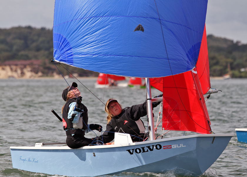 Blue Mirror dinghy with crew and helm fully focused on the spinnaker