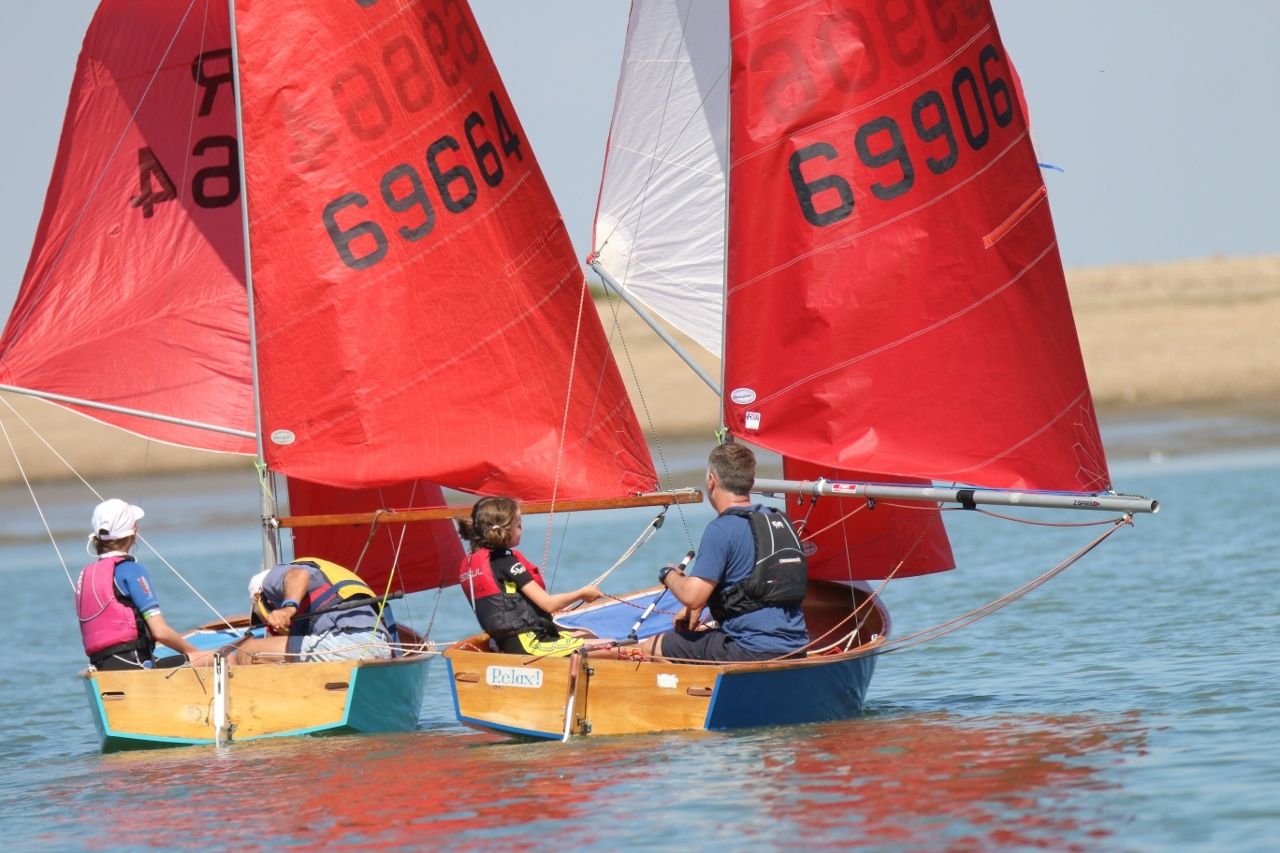 Two Goodwin built wooden Mirror dinghies racing under spinnaker