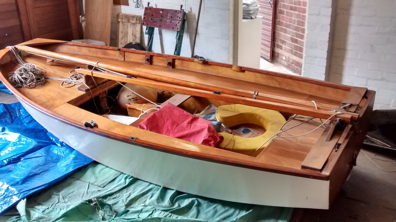 Wooden Mirror dinghy in a garage