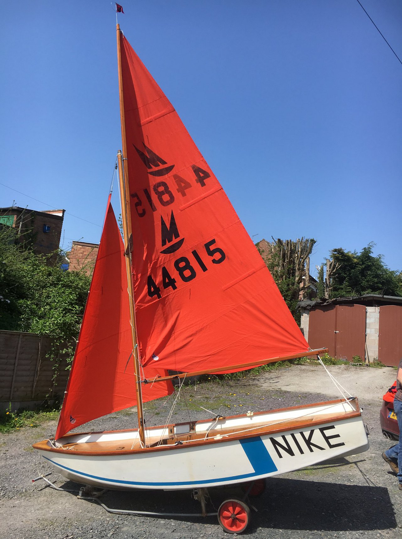 A Mirror dinghy rigged in a back yard