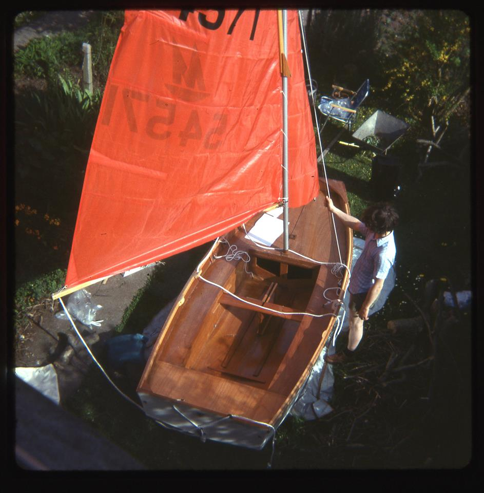 A new wooden Mirror dinghy rigged up in a garden and photographed from an upstairs window