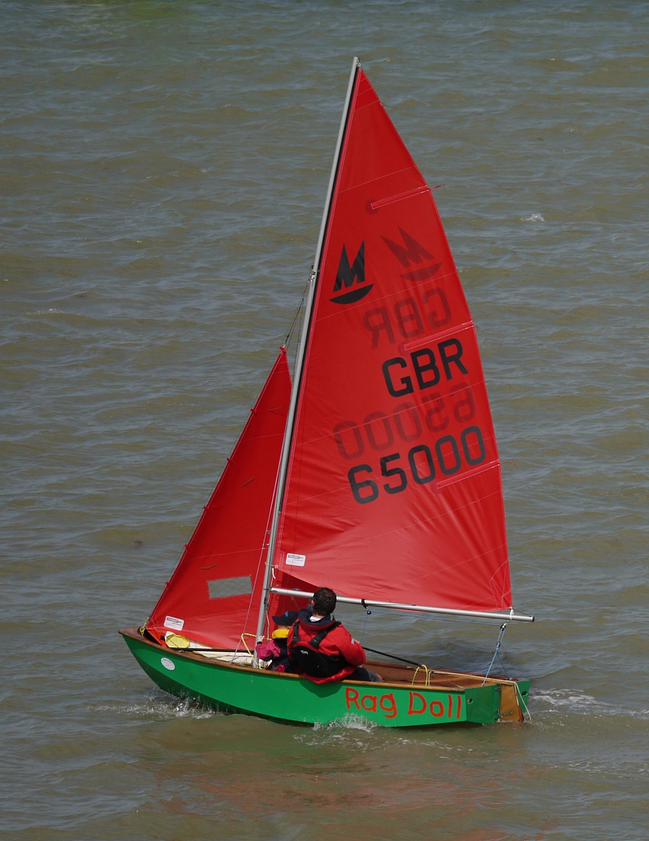 A green Mirror dinghy sailing to windward