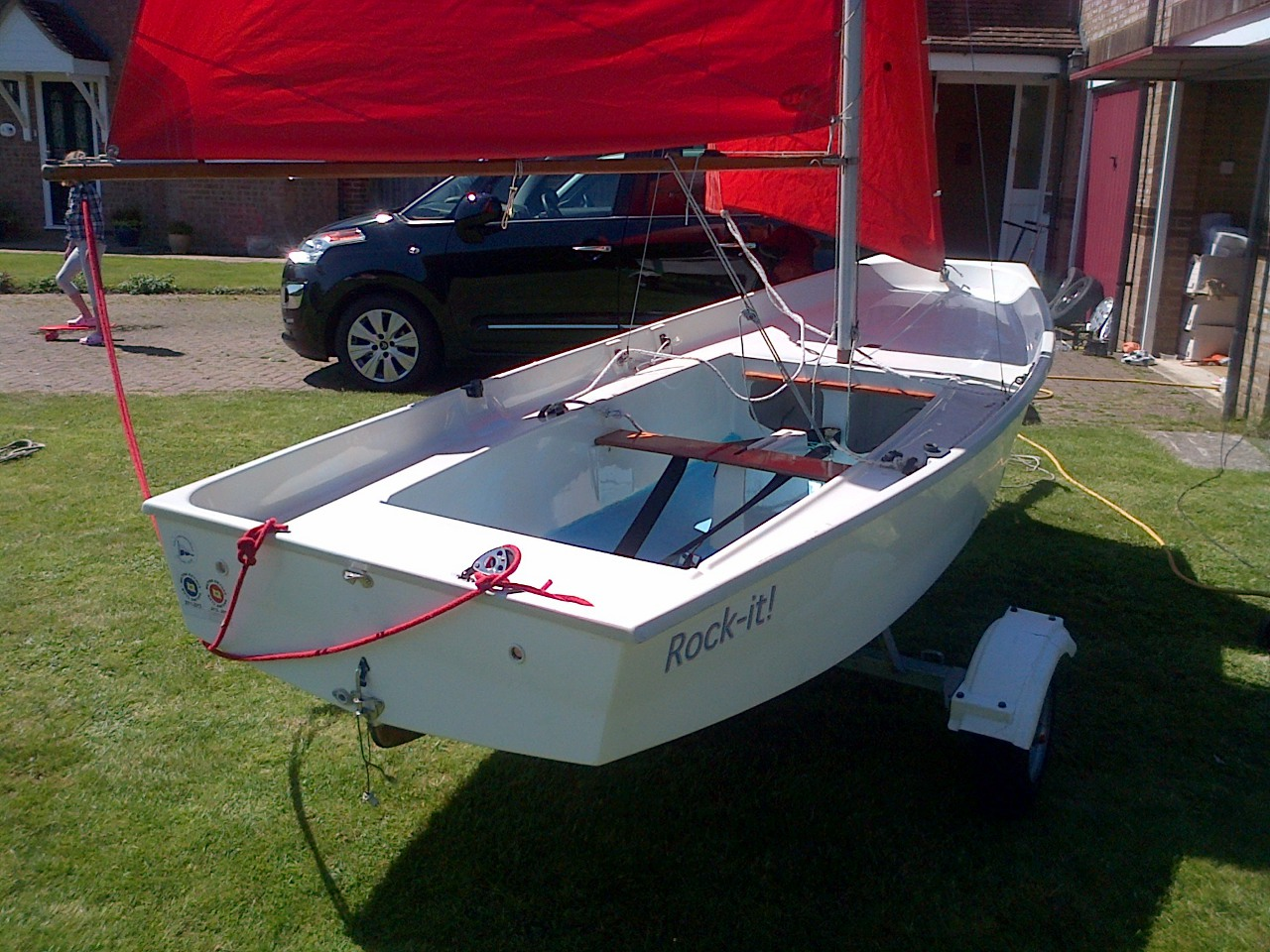 What is thought to be a Holt GRP Mirror dinghy rigged up on a lawn