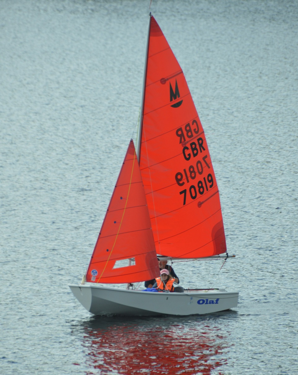 A white Mirror dinghy sailing on a lake