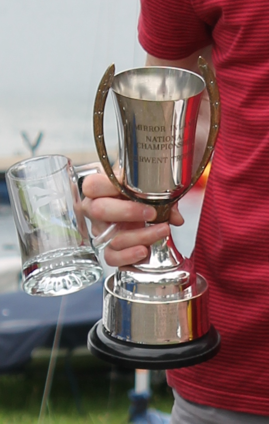 A silver cup with handles which extend above the rim